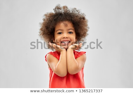 happy little african american girl over grey stock photo © dolgachov