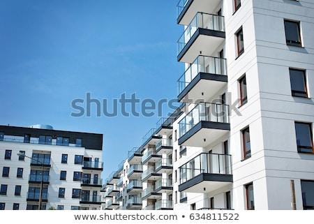 Homlokzat új lakás ház nagy épület Stock fotó © elxeneize