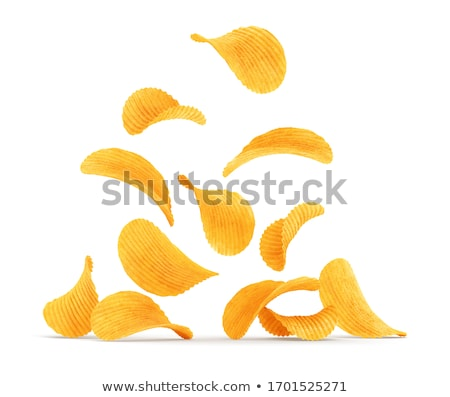 Grooved potato chips falling down. Rippled wavy snack food Stock photo © LoopAll