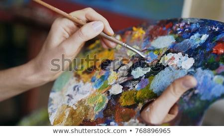 Mãos pintura cor paleta escove conselho Foto stock © yupiramos