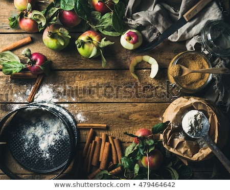 close up of apple pie in mold on wooden table Stock photo © dolgachov