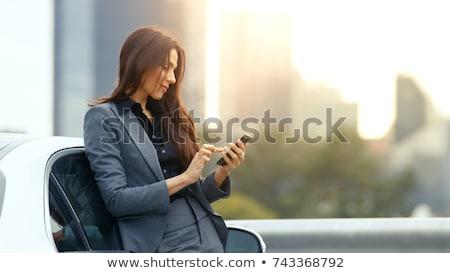 pletyka · telefon · derűs · nő · beszél · asztal - stock fotó © photography33