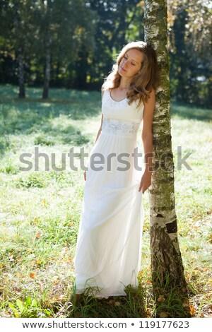 woman posing on grass Stock photo © smithore