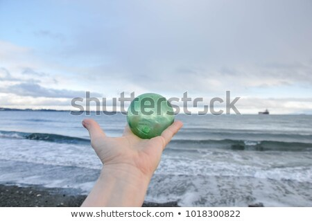 seashells on sand with glass ball on white Stock photo © 808isgreat