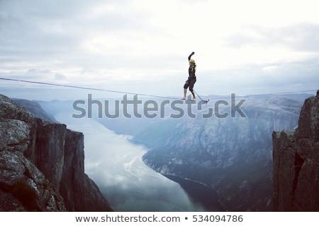 ходьбы туго натянутый канат бизнесмен ходьбе изолированный белый Сток-фото © RTimages