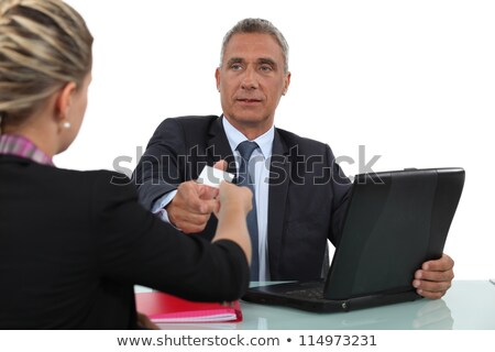 Woman giving a man her businesscard Stock photo © photography33