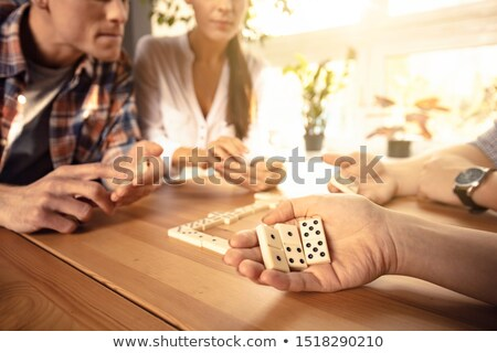 happy couple playing dominos with daughter stock photo © photography33