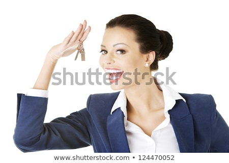 portrait of a real estate agent holding keys against a white background stock photo © wavebreak_media