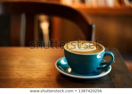 Beker koffie schuim houten tafel thee biscuits Stockfoto © justinb