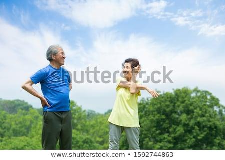 Nyújtás narancs rajzfilmfigura sport fehér gyógyszer Stock fotó © limbi007