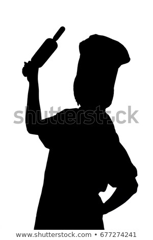 Happy woman in chef clothing holding rolling pin stock photo © wavebreak_media
