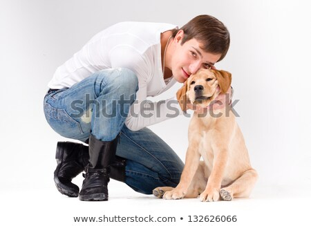 handsome man with dog over gray stock photo © stepstock