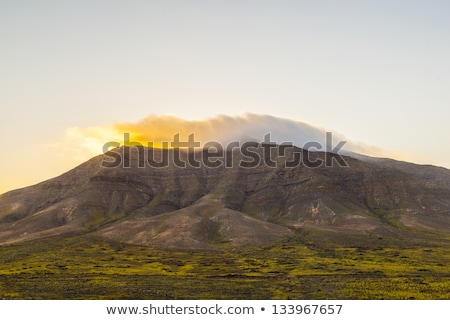 sunrise over Femes mountains seen from Playa Blanca, Lanzarote Stock photo © meinzahn
