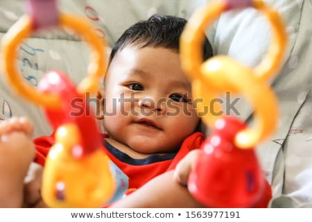 toddler with toy and red shirt crawling Stock photo © gewoldi