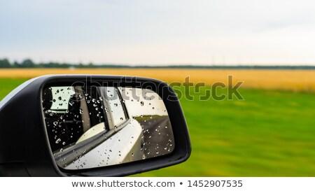 Car Side View Mirror with Rain Drops Stock photo © tainasohlman