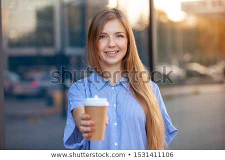 Young woman offering drink Stock photo © jiri_miklo