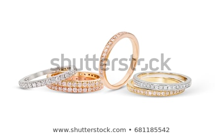 background with gold rings set with precious stones stock photo © yurkina