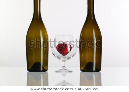 Dwa butelek czerwony serca wewnątrz szkła Zdjęcia stock © CaptureLight
