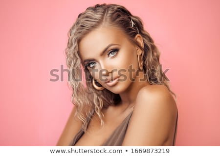 Fashion Beautiful girl with Long Wavy Hair wearing in golden jew Stock photo © Victoria_Andreas