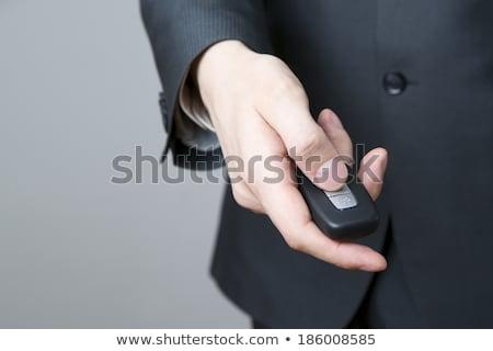 Businessman holding black remote control  Stock photo © wavebreak_media