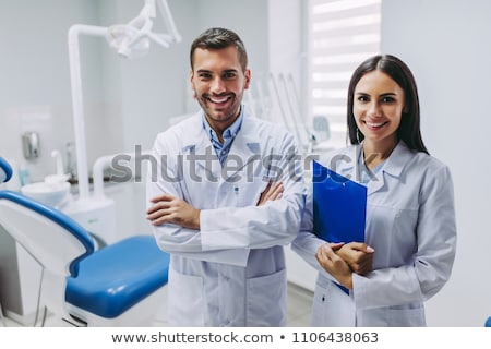 Tandarts glimlachend camera tandheelkundige Stockfoto © wavebreak_media