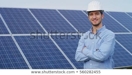 Sorridente jovem técnico trabalhando comprimido servidor Foto stock © wavebreak_media