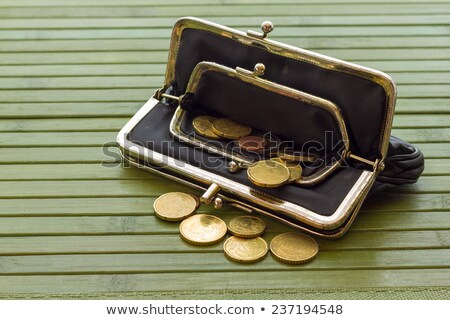 Dollars in red leather purse isolated on white background Stock photo © tetkoren