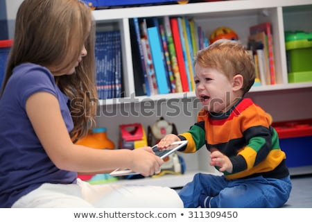 girl and her little brother crying and arguing with a digital ta Stock photo © vladacanon