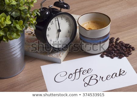Coffee beans, cup of coffe and diary  Stock photo © CaptureLight