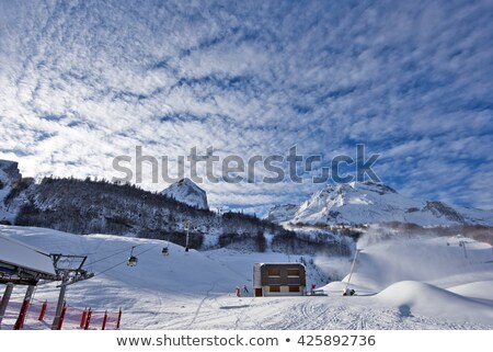 ski slope with snowmaking at sun morning stock photo © bsani