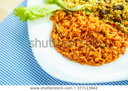 Delicious dish made of two kinds of rice on a white plate and a  Stock photo © vlad_star