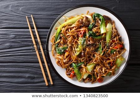 Stir frying spring onion and garlic Stock photo © Digifoodstock