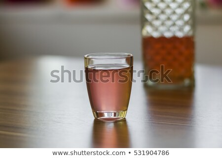 liqueur from malberry in a shot glass stock photo © zoryanchik