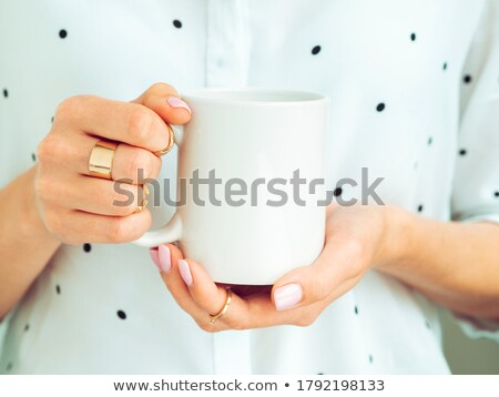 woman holding a white cup of coffee stock photo © stevanovicigor
