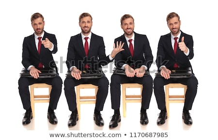 laughing young man making the ok and sits on chair stock photo © feedough