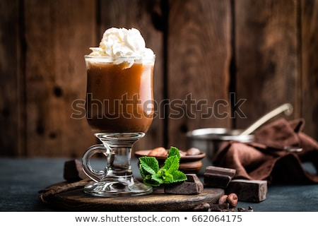 Iced cocoa drink with whipped cream, cold chocolate beverage, coffee frappe on dark background Stock photo © yelenayemchuk