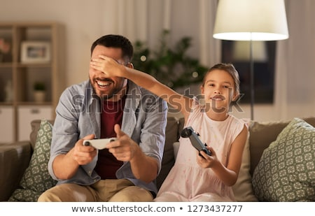 Happy girl with a gamepad. Video gamer Stock photo © Nobilior