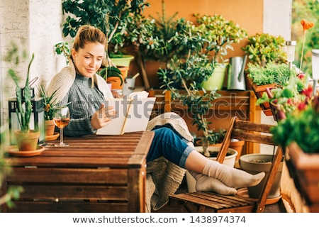 Girl with plant in green house Stock photo © IS2