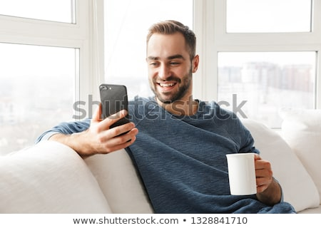 Foto stock: Moço · telefone · móvel · quarto · bonito · sorrir · móvel