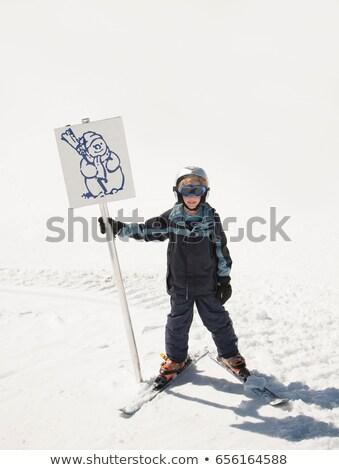 Chłopca narciarz snowman podpisania zimą Zdjęcia stock © IS2