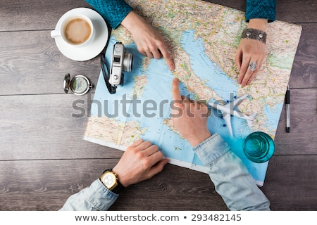 young couple looking at compass stock photo © is2