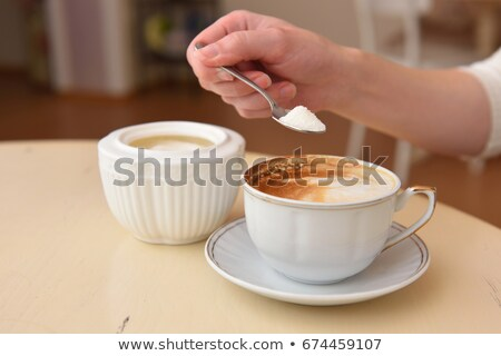 Woman hand pouring sugar from spoon Stock photo © wavebreak_media
