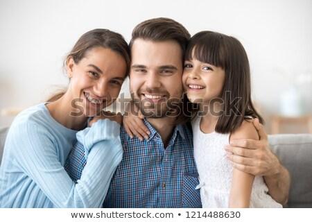 família · praia · piquenique · sorridente · criança · mar - foto stock © deandrobot