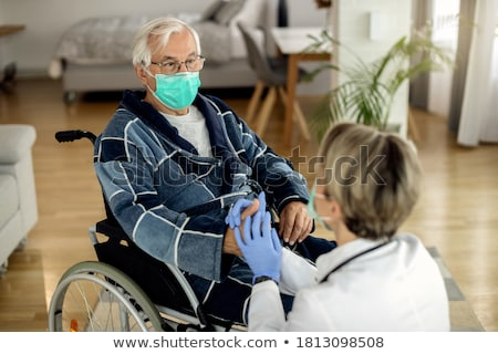 female doctor consoling distraught senior adult woman stock photo © feverpitch