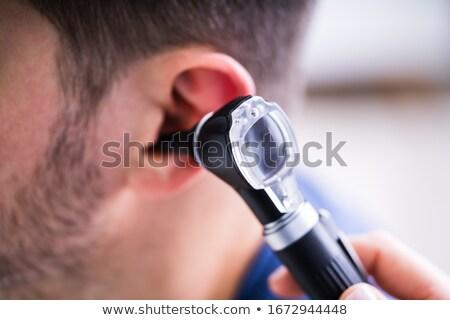 Doctor Examining Patient's Ear With Otoscope Stock photo © AndreyPopov
