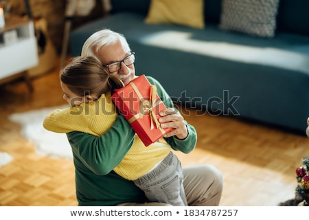 girl with present at christmas stock photo © choreograph