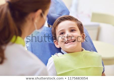 Tandartsen gelukkig kid patiënt tandheelkundige kliniek Stockfoto © dolgachov