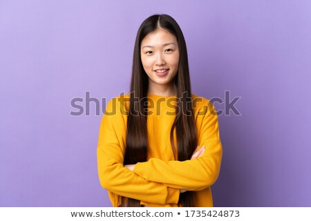 Happy asian woman posing isolated over purple wall background holding passport and tickets. Stock photo © deandrobot