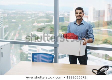 Successful Confident Businessman Moving To New Office Looking At Camera Stock photo © diego_cervo