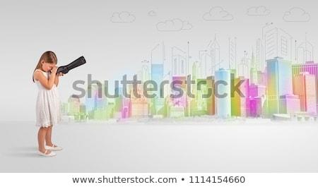 Kid looking through spyglass to a big city Stock photo © ra2studio